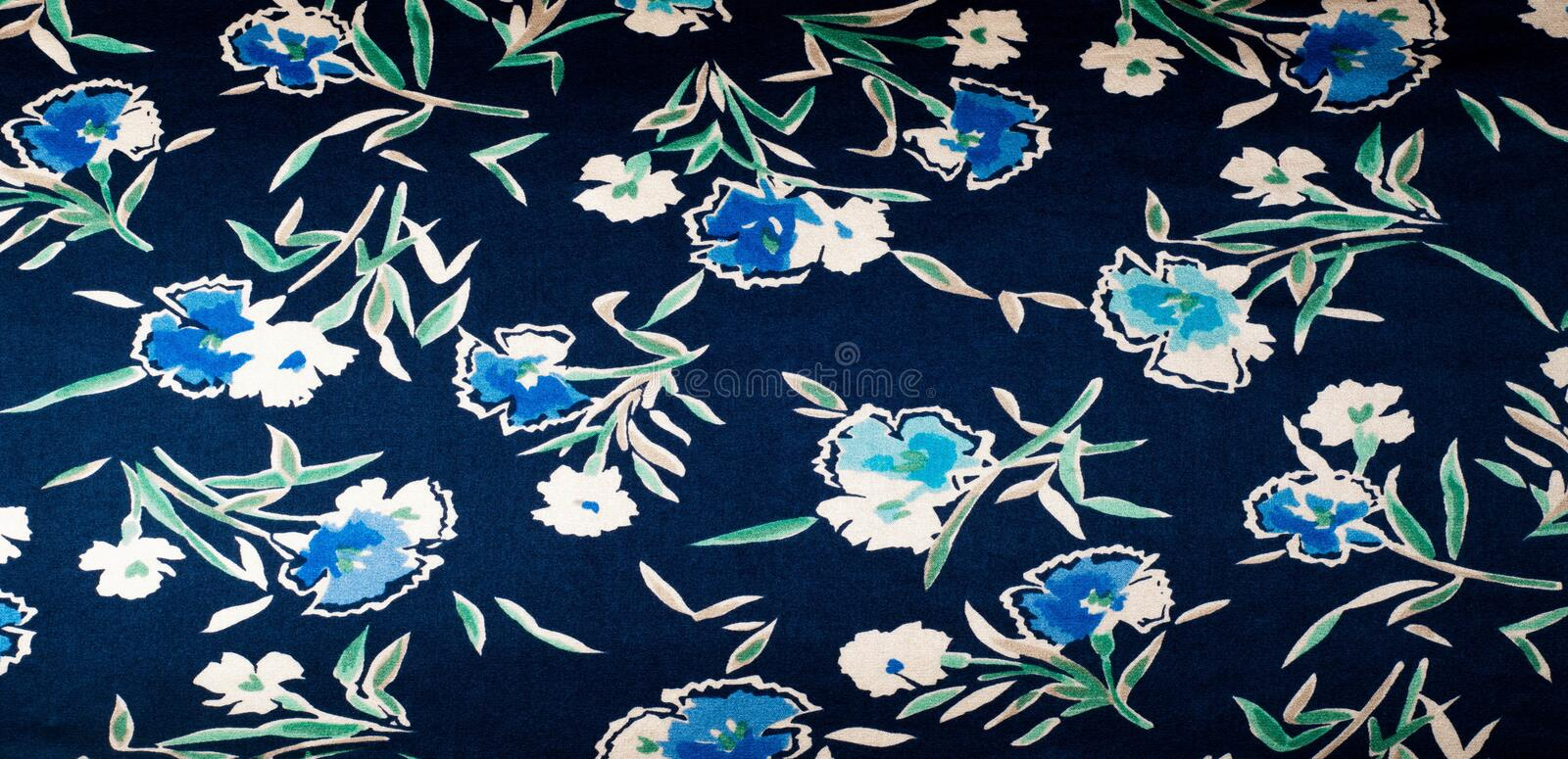 Fabric silk texture blue, flowers, abstract. A fine, strong, soft, lustrous fiber produced by silkworms in making cocoons and collected to make thread and stock photos