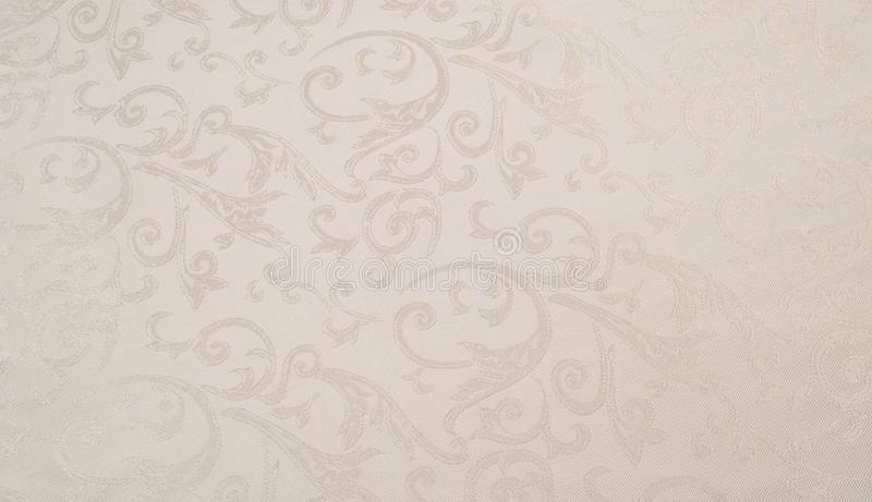 Fabric silk texture, creamy, pale beige. Fabric silk texture, cream, cream-colored, cream-coloured, pale beige. a fine, strong, soft, lustrous fiber produced by royalty free stock images