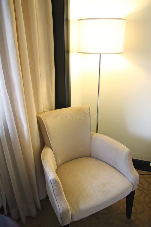 Fabric sofa. Single seat fabric sofa with lamp next to window stock image