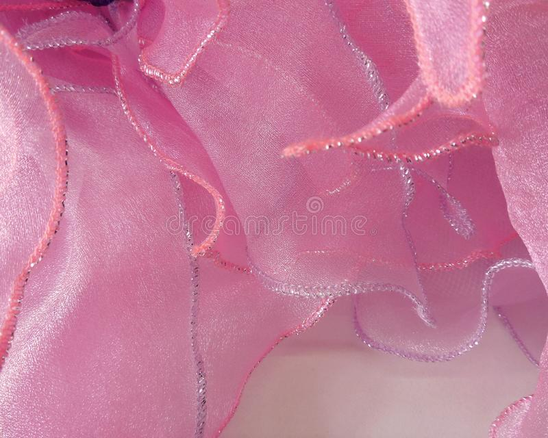The fabric is soft, pink, stitched background stock photo