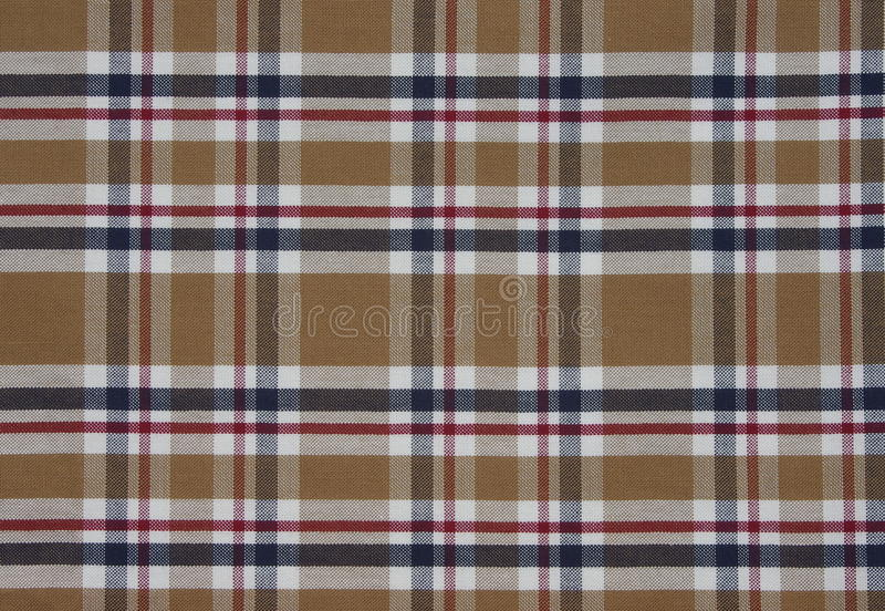 Fabric Tartan pattern. Brown. With red, white and blue stock photos