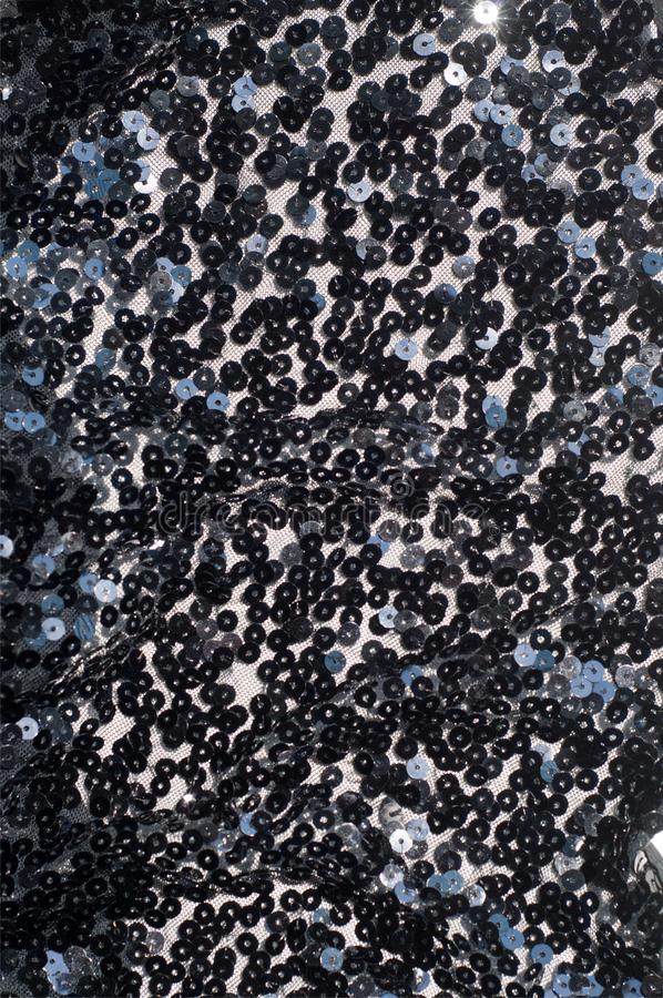 Fabric texture, background, black sequined. Tinsel, trumpery, frippery, gaud, gewgaw, gimcrack stock photos