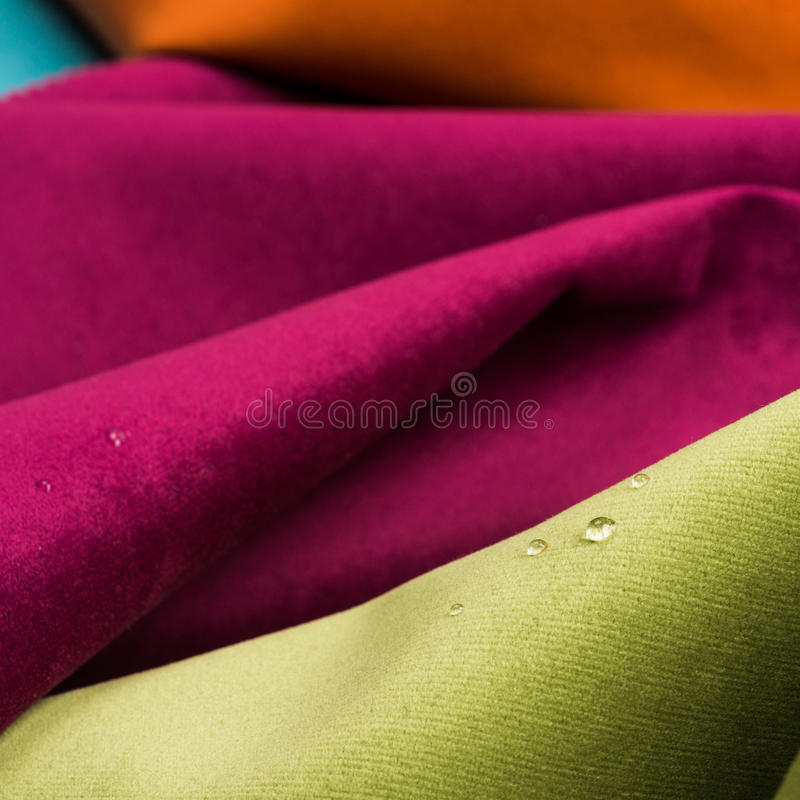 Fabric texture background. Macro shot of fine fabric texture background with water drops stock images