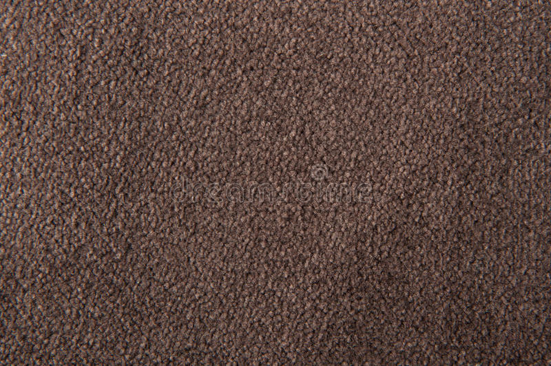 Fabric texture brown carpeting royalty free stock images
