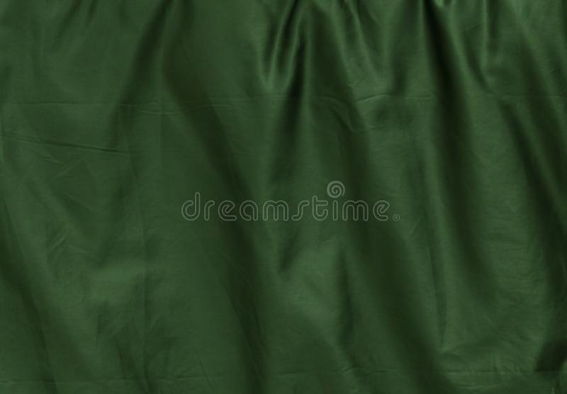 Background Pattern of Crumpled Green Textile Texture royalty free stock images