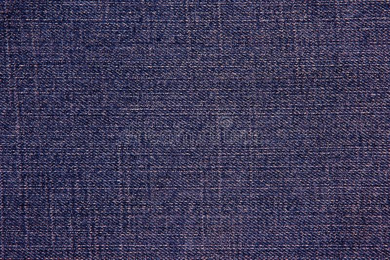 Fabric texture denim pants. The fabric texture denim pants royalty free stock photos