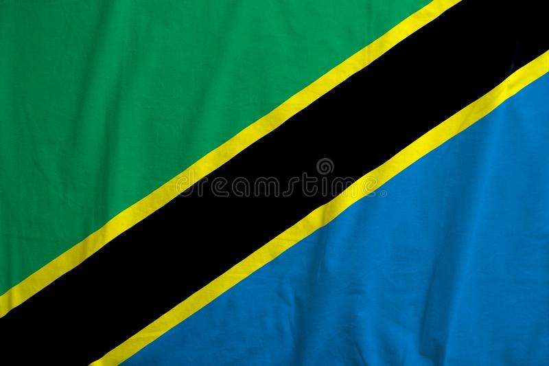 Flag Of Tanzania waving. Fabric texture of the flag of Tanzania royalty free stock image