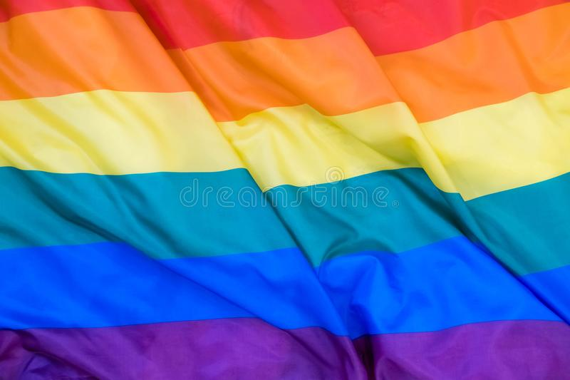 Fabric texture of the Gay flag background. LGBT waving flag stock image