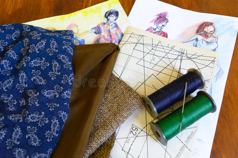 Fabric, threads, needle, drawings, schemes, patterns royalty free stock images
