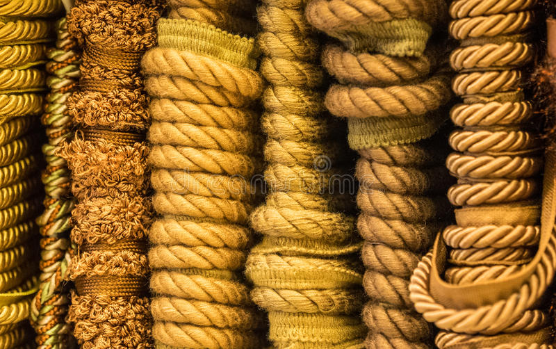 Fabric trim textures. Gold fabric trim creates a mixture of textures royalty free stock images