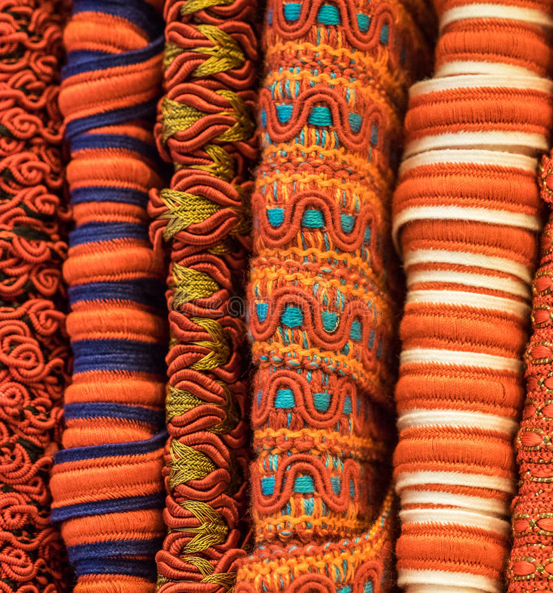 Fabric trim textures. Orange fabric trim creates a mixture of textures royalty free stock photography