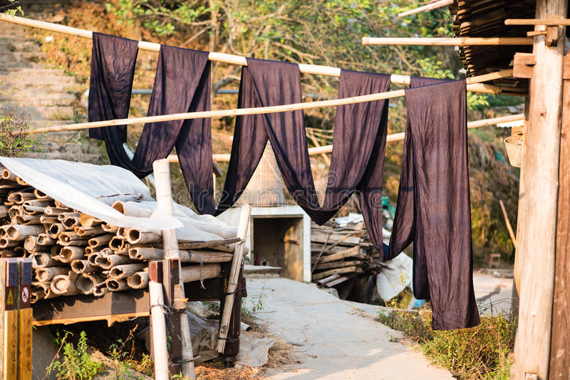 Fabric used for traditional Miao minority costumes. Hanging to dry in the sun royalty free stock image