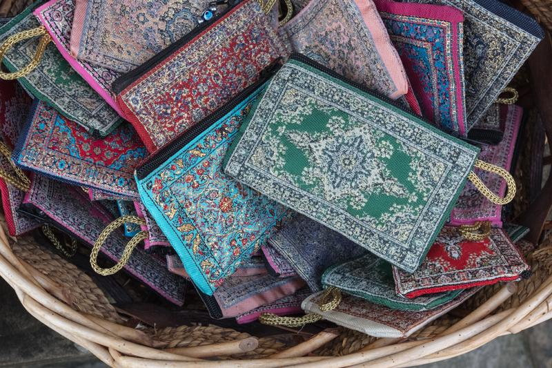 Fabric wallets with intricate sewn patterns in Bulgarian souvenir store stock photography