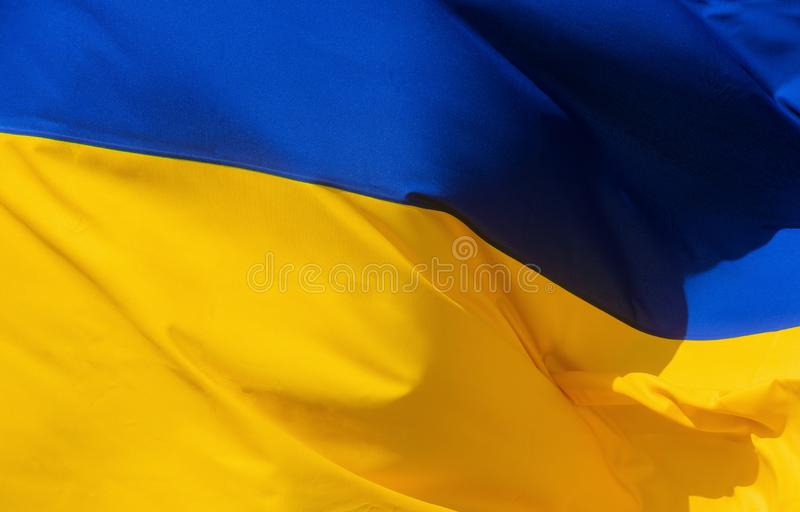 Fabric waving flag of Ukraine. The national yellow and blue flag, ukrainian, symbol, country, banner, patriotism, europe, patriotic, freedom, sign, wave stock photos