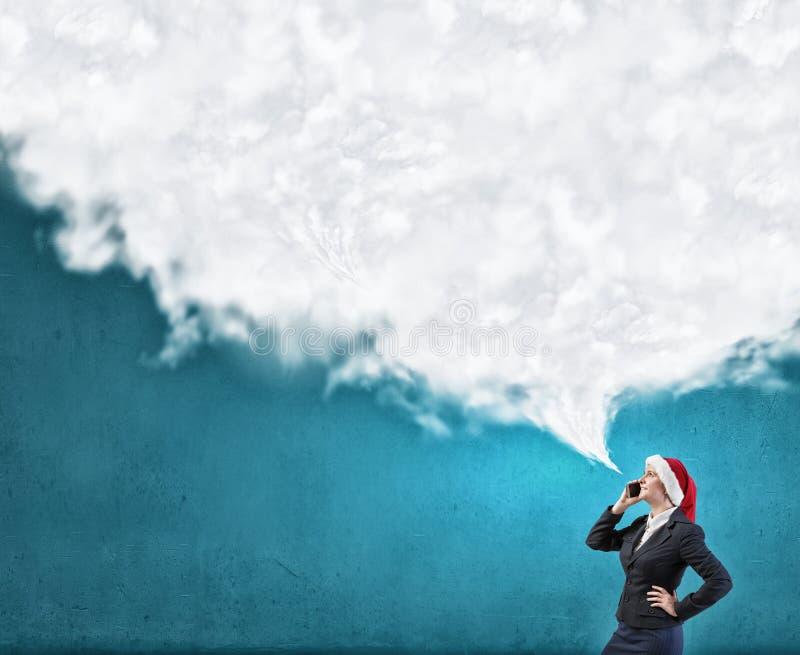 Fabricación de llamadas de la Navidad fotos de archivo
