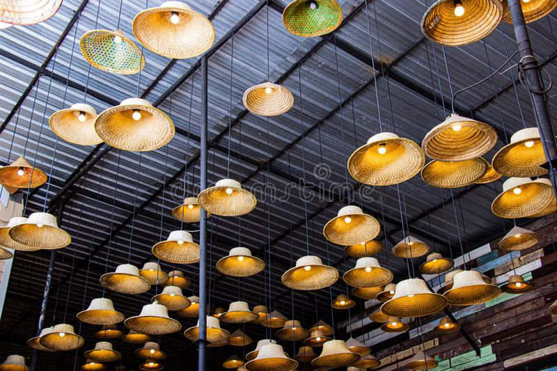 Fabricated lamp from a hat made of local materials bamboo inside restaurant at Amphawa floating market is the tourist most popular. In Thailand stock image