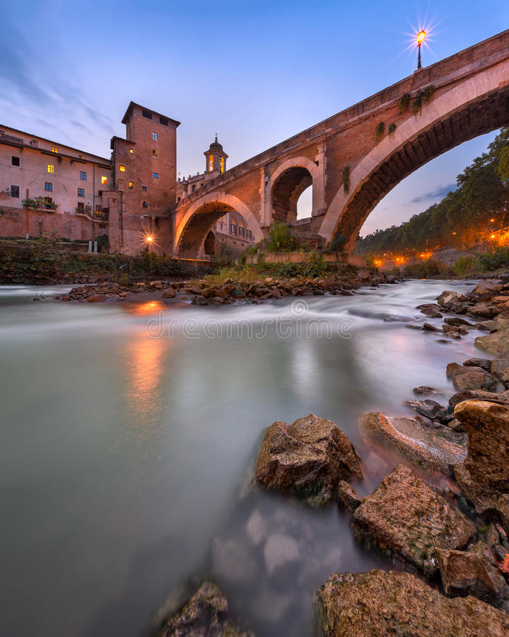 Fabricius Bridge and Tiber Island in the Evening, Rome, Italy stock image