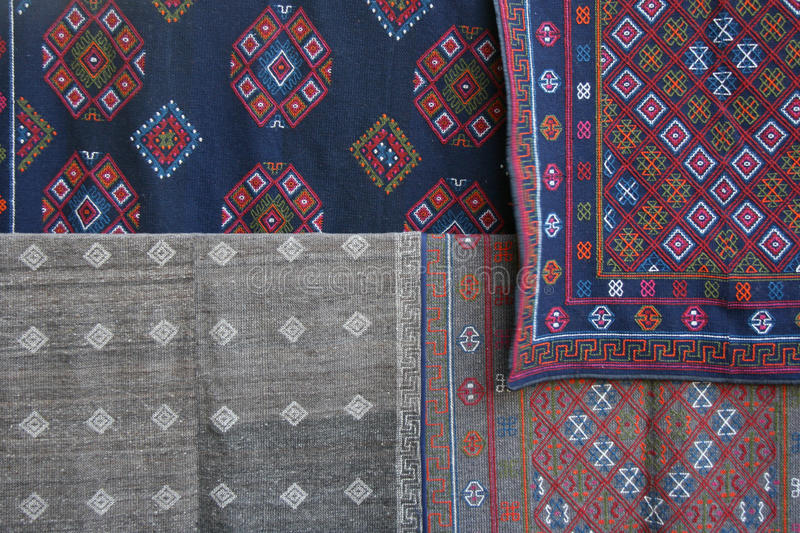 Fabrics decorated with embroidered patterns are sold at the market of a village near Gangtey (Bhutan). Fabrics decorated with embroidered patterns are sold at stock images