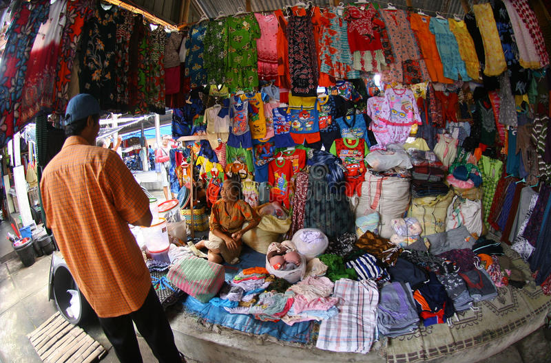 Fabrics and garments. Merchants selling fabrics and garments in a village market in Sukoharjo, Central Java, Indonesia stock images