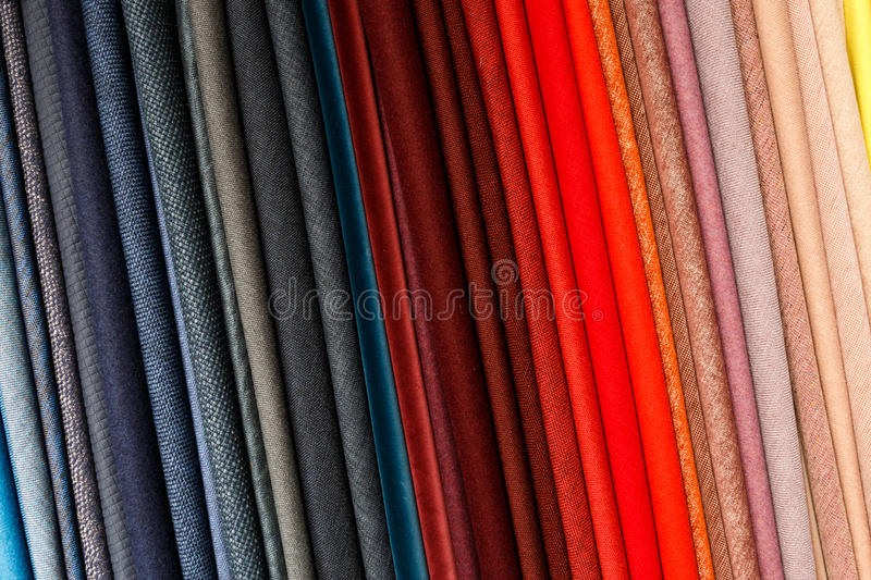 Fabrics. Tilted colored fabrics in different colors royalty free stock images