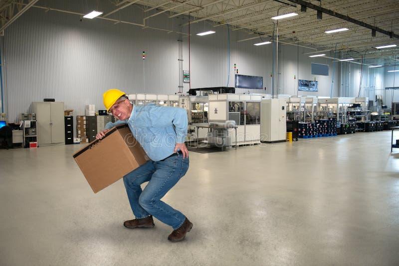Fabriksarbetare, tillbaka skada, säkerhet arkivbilder