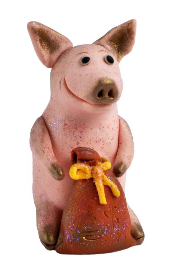 Fabriqué à la main : porc avec un sac de mone photos libres de droits