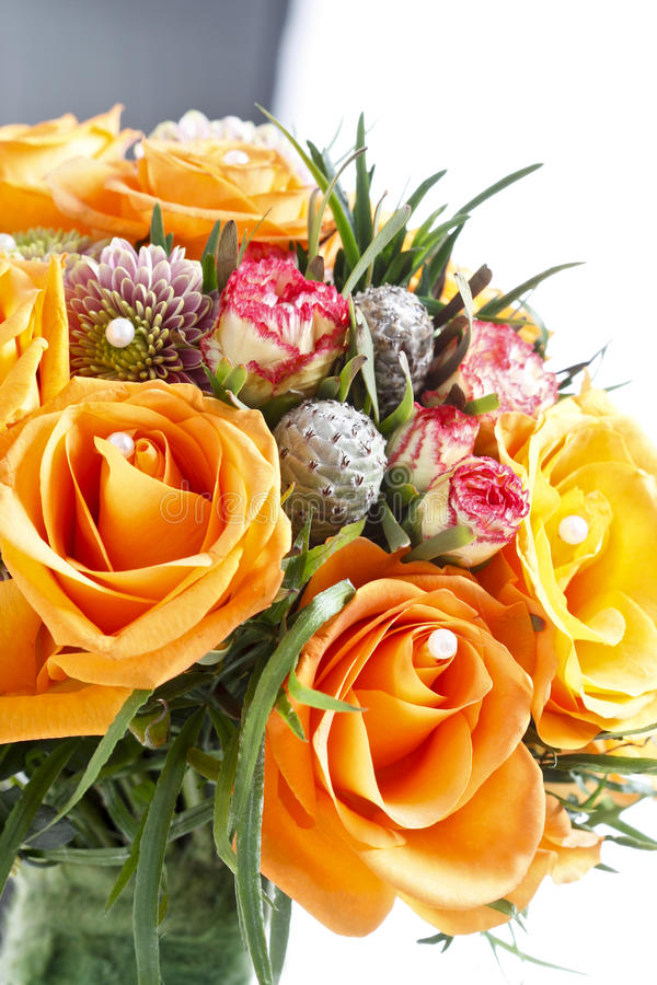 Fabulous Bouquet Of Orange Roses And Other Flowers Stock Image