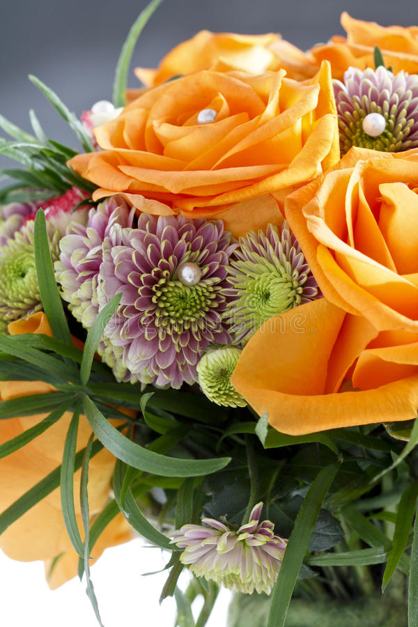 Fabulous Bouquet Of Orange Roses And Other Flowers Stock Photo