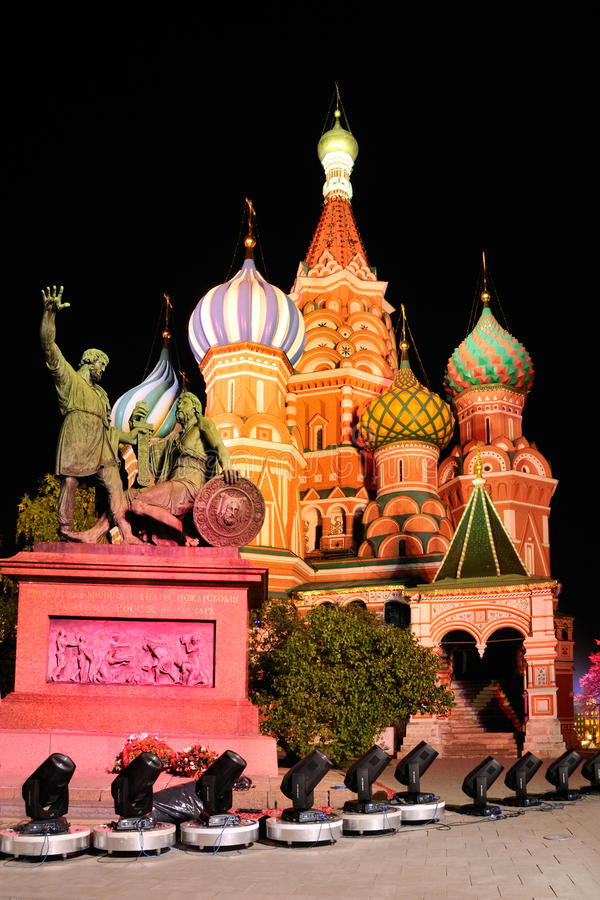 Fabulous Colors of St. Basil`s Cathedral on the Red Square. MOSCOW, RUSSIA - Fabulous colors of illuminated St. Basil`s Cathedral 1555-1561 and monument to Minin royalty free stock photography
