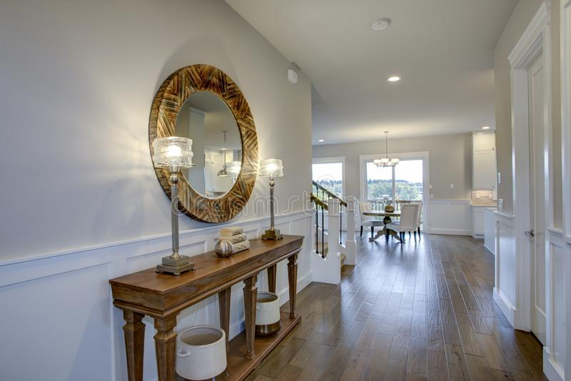 Fabulous foyer features a wood console table royalty free stock image