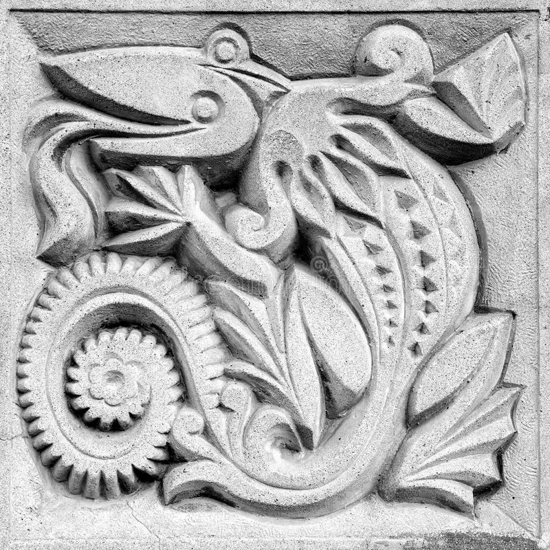 Fabulous lizard, bas-relief stock images