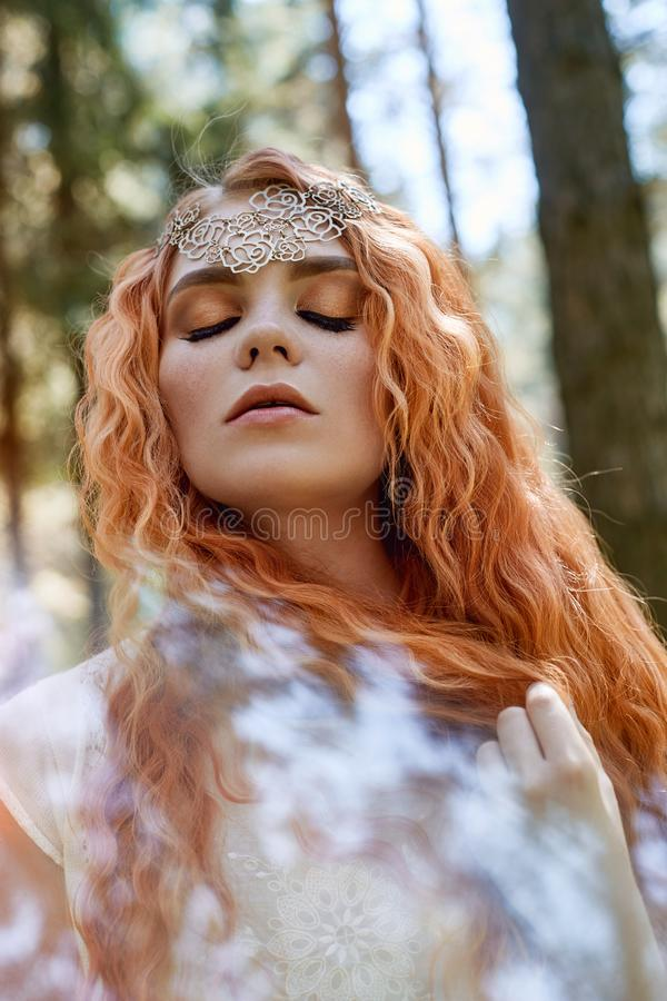 Free Fabulous Portrait Of A Red-haired Girl In Nature With Double Exposure And Glare. Beautiful Redhead Girl With Long Hair In Forest Stock Images - 131426184