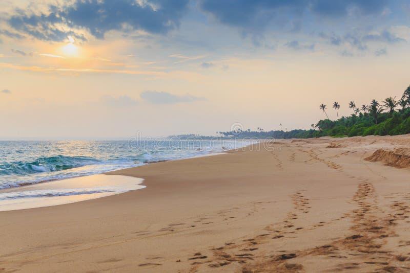 Fabulous sunset on a beautiful tropical beach royalty free stock photo