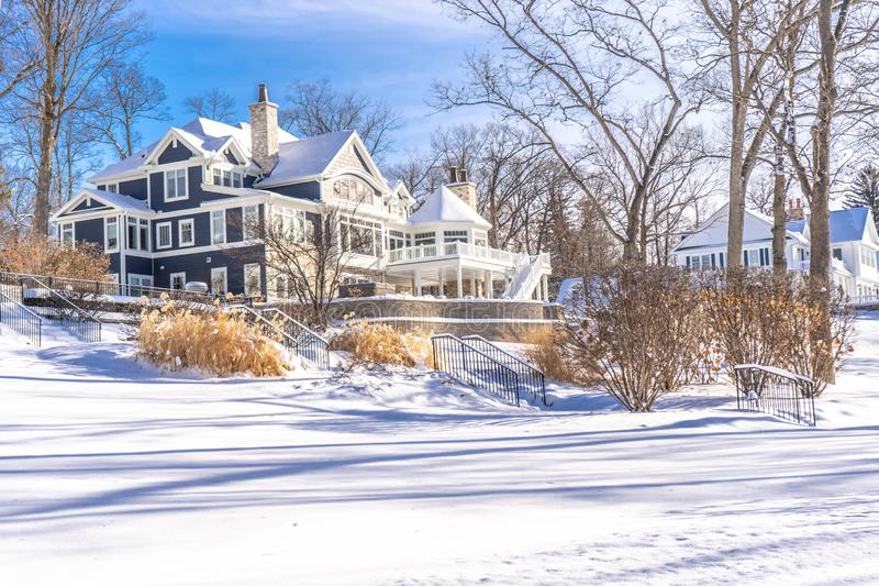 Fabulous winter landscape with a beautiful snowy-covered houses at Lake Geneva WI , USA 01/27/2019 royalty free stock image