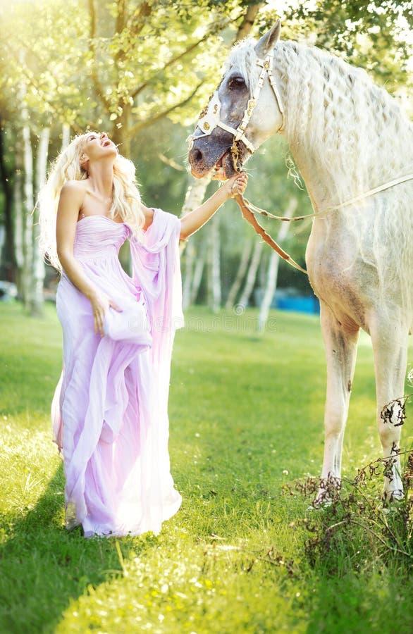 Fabulous woman with beautiful horse royalty free stock photo