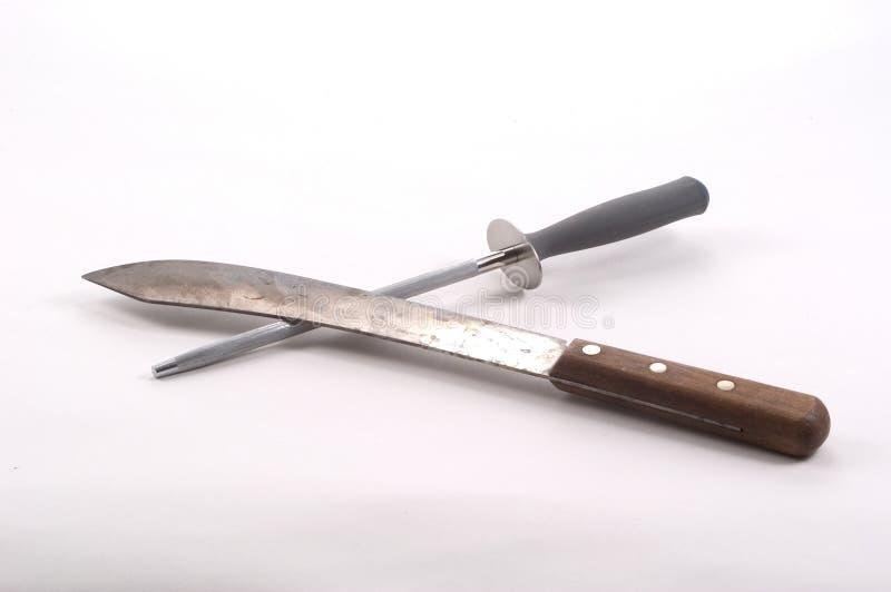Faca e aço Sharpening foto de stock