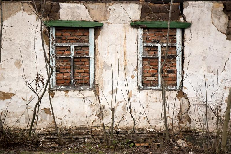 The wall of an abandoned building in the Donbass stock photos