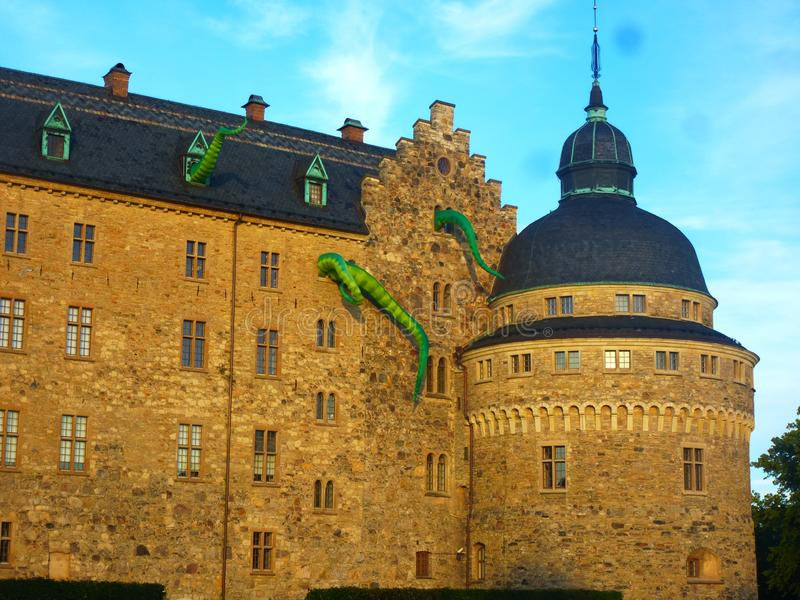 Facade of the ancient castle with dragons during the cultural festival. Orebro, Sweden, Europe, July 12, 2019 royalty free stock image