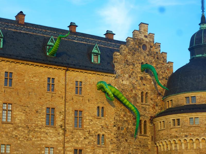 Facade of the ancient castle with dragons during the cultural festival. Orebro, Sweden, Europe, July 12, 2019 royalty free stock photo