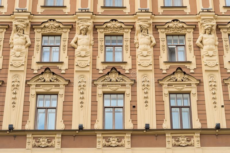 Facade of an Art deco building with ornaments and statues in Saint Petersburg stock photography