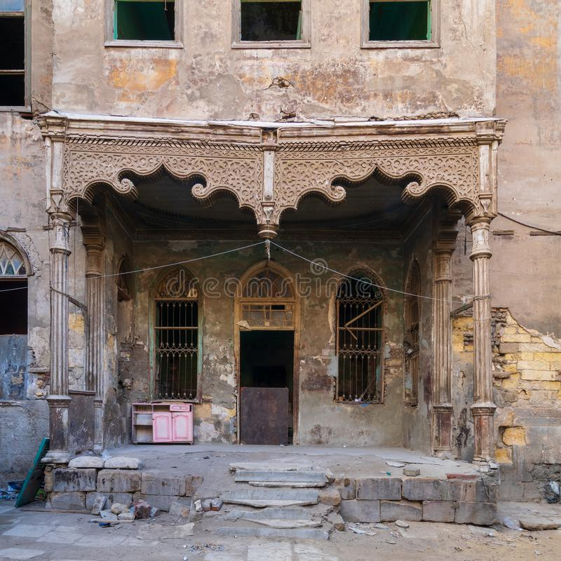 Facade of Bayt Madkour Pasha historic abandoned house, Souq Al Selah Street, Old Cairo, Egypt. Facade of Bayt Madkour Pasha historic abandoned house located at stock image