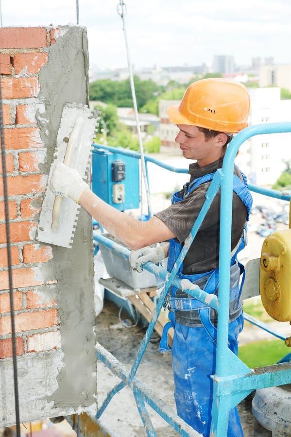 Download Facade Builder Plasterer At Work Stock Photo - Image: 26899126