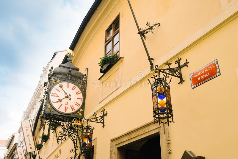 Facade of the building and clock of the famous and ancient U Fleku brewery. Prague, Czech Republic - May 22, 2018: Facade of the building and clock of the famous stock photo