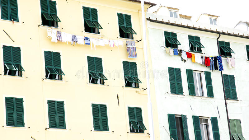 Facade of a building with clothes hanging. Marseille, France royalty free stock images