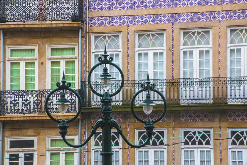 Facade of the building in Porto, Portuglia, decorated with multi-colored ceramic tiles azulejo.  royalty free stock photos