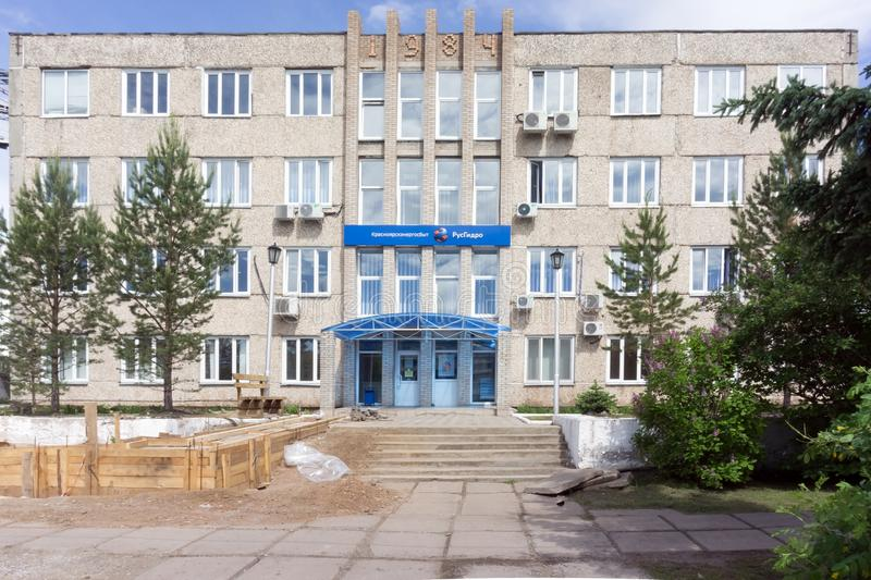 Facade of the building of the Russian company for the sale of electricity with signs Krasnoyarsk-energy sales and RusHydro in the. Sharypovo, Krasnoyarsk region stock image