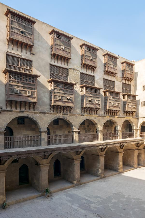 Facade of caravansary of Bazaraa, with vaulted arcades suited in Gamalia district, Medieval Cairo, Egypt. Facade of historic caravansary of Bazaraa, with vaulted stock photos