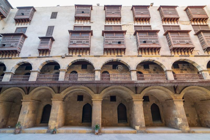 Facade of caravansary of Bazaraa, with vaulted arcades and wooden oriel windows, Cairo, Egypt. Facade of historic Wikala of Bazaraa building, with vaulted stock photo