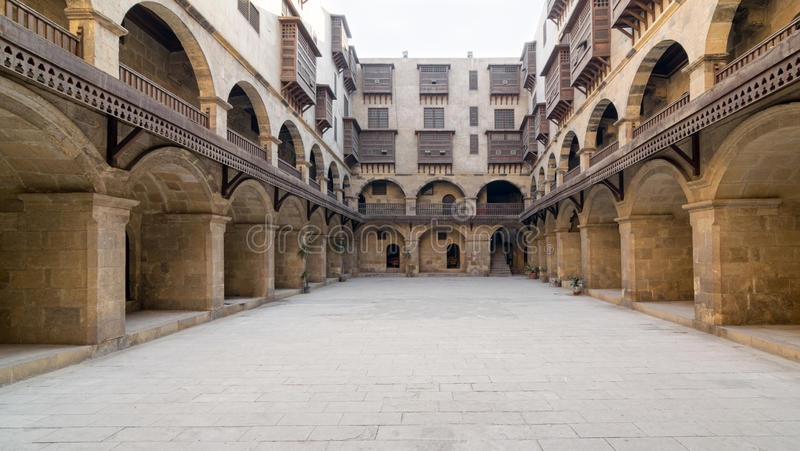 Facade of caravansary Wikala of Bazaraa, , Medieval Cairo, Egypt. Facade of caravansary Wikala of Bazaraa, with vaulted arcades and windows covered by royalty free stock images