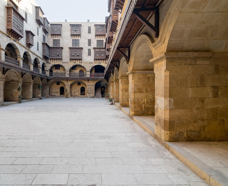 Facade of caravansary Wikala of Bazaraa, , Medieval Cairo, Egypt. Facade of caravansary Wikala of Bazaraa, with vaulted arcades and windows covered by stock images